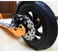 Novatrack POLIS 200DB самокат с ручным дисковым тормозом (оранжевый)